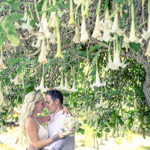 Groom & Bride with Iochroma Bell Flowers at Shelly Beach