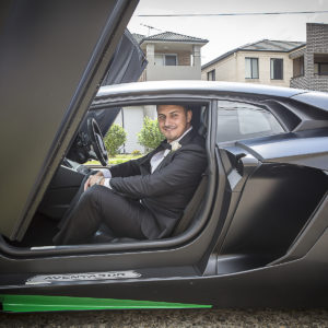 Wedding Photo for Groom sitting in lamborghini aventador matt black green