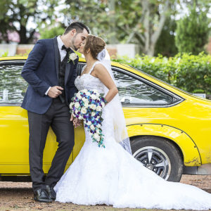 Groom and Brides next to their wedding classic car at Holroyd Garden