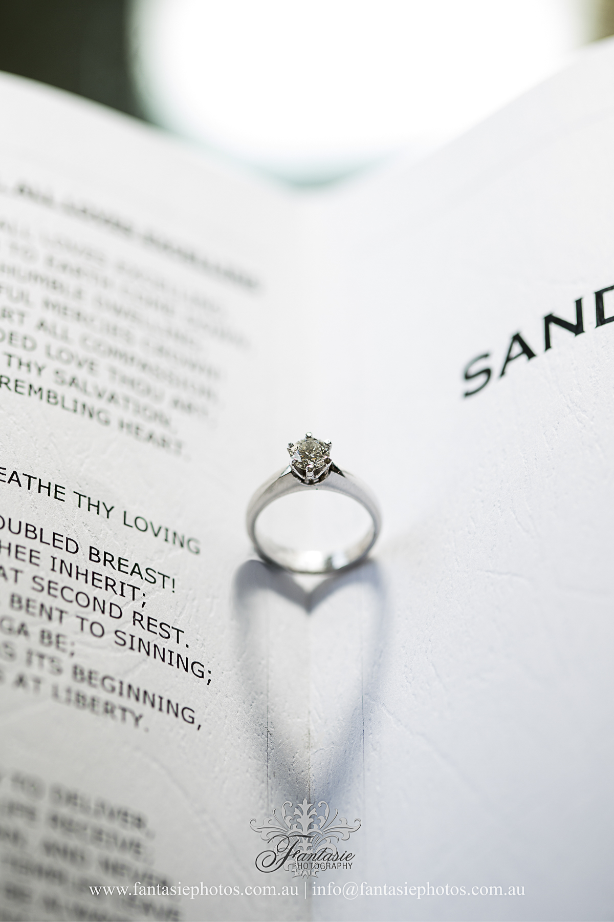 Love heart wedding engagement diamond ring in the book photo | Fantasie Photography