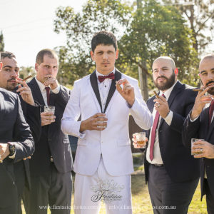Wedding Photography | Grooms & Groomsmen Lighting up their cigars | Fantasie Photography
