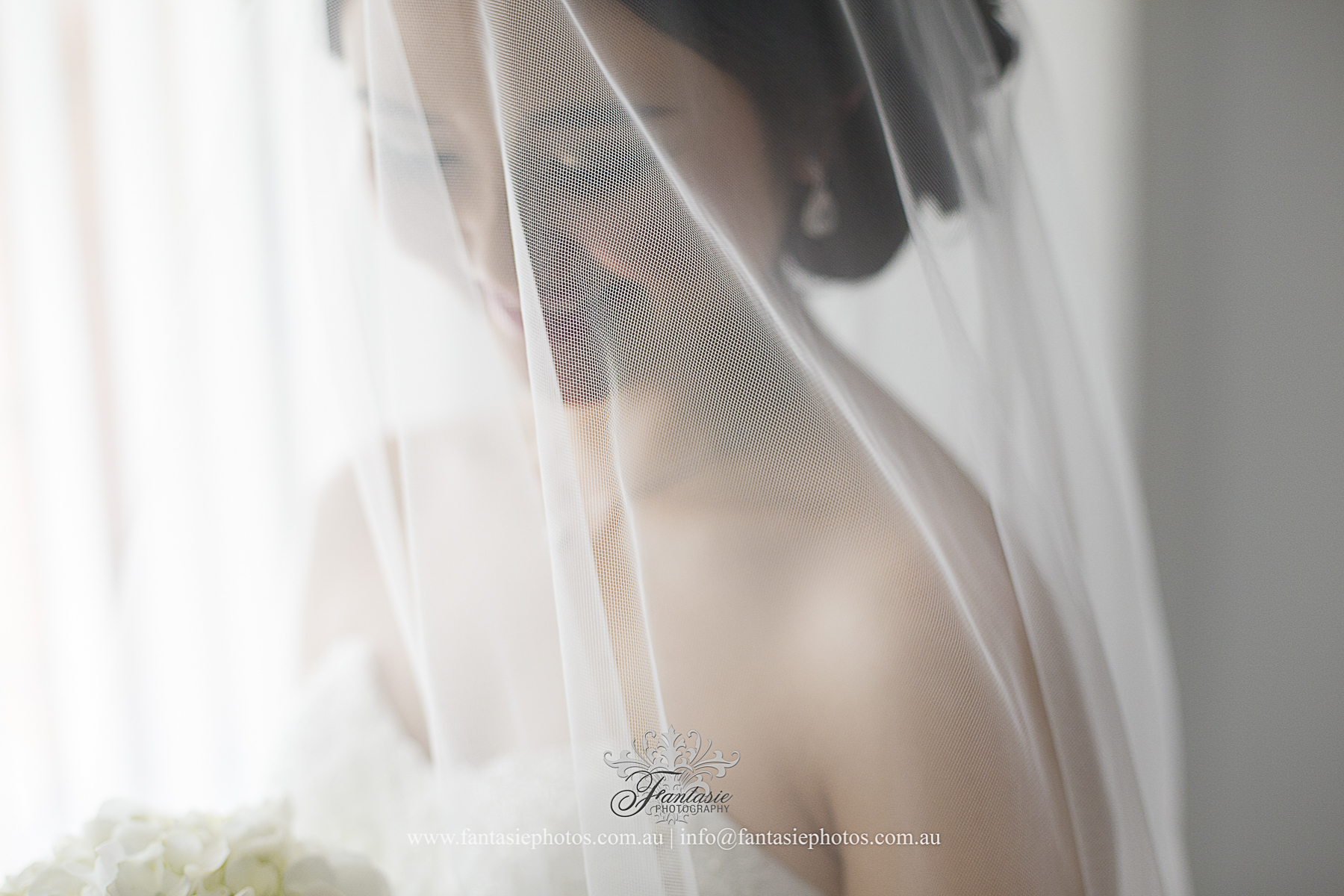 Veil Covering Bride getting ready at home