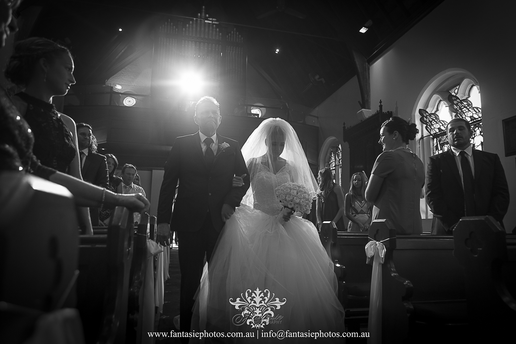 Bride and father of bride entrance at church with special lighting effect at St Anne Ryde