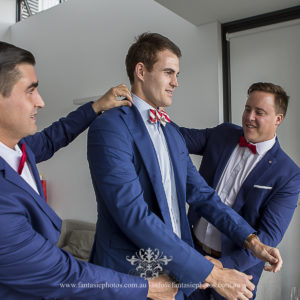 Groomsmen getting ready for groom at home Lindfield