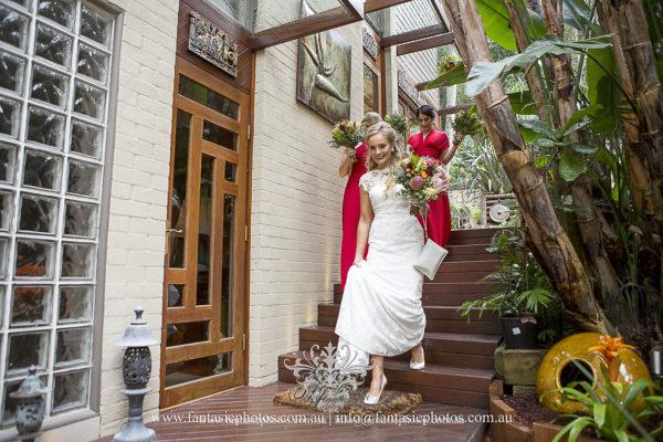 Bride and bridesmaid leaving home to wedding ceremony