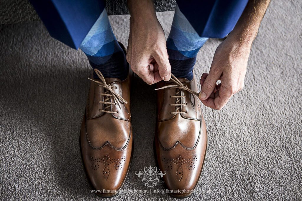 Groom tie his stunning shoe laces wedding shoes captured