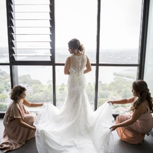 Bride and bridesmaids beautiful wedding dress preparation photo | Fantasie Photography