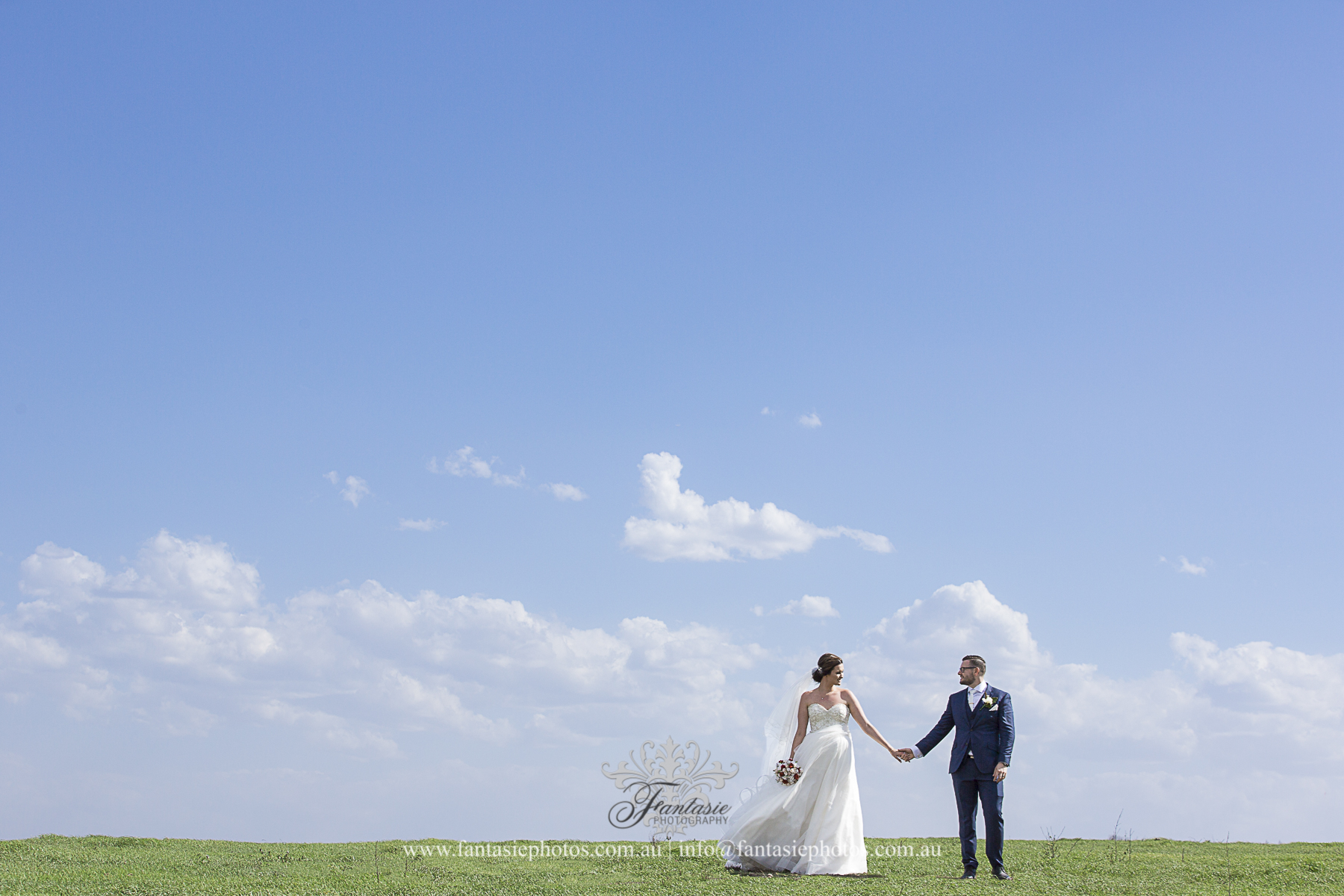 Wedding Photography at Ottimo House Campbelltown | Groom & Bride on the grass field | Fantasie Photography